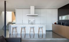 Push open (no handles) White Laminate Kitchen Cabinets, contemporary, sleek, minimalist, formica, easy to clean.