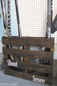 I love this idea for repurposing a pallet into a sports equipment organizer for the garage!