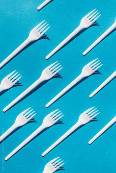 composition, food,White fork, blue background by IgorMadjinca | Stocksy United