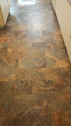 This is a modular vinyl tile from Armstrong Alterna. The cobblestone pattern used 3 sizes to give this old world look. Very easy to maintain, just mop like a regular vinyl floor. Stain resistant acrylic grout does not need to be sealed. Tile is guaranteed to not rip, tear or gauge. https://www.facebook.com/nufloorslangley