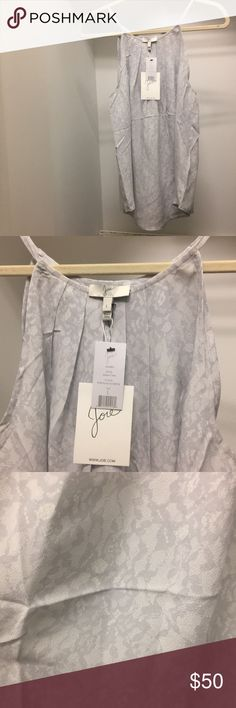 Joie Silver Sleeveless Blouse Size L NWT Joie Silver Silk Sleeveless Blouse with lace pattern size large! NWT!! Great piece for layering, holiday parties and New Years Eve! 100% Silk! Purchased at Neiman Marcus Joie Tops Blouses