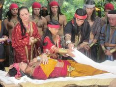 Ancient Philippine burial ritual. Viewing and vigil are common burial practices that transcend cultures. Here we see a dead body being covered in a shroud.