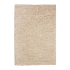 $149, Adum Rug 6'7 x 9'10, Ikea - This rug is super plush and soft, a great price, and a neutral color. Perfect for under the patterned ottoman in the sitting area!