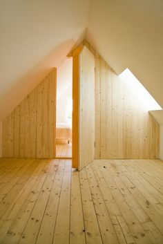 Hidden Room in Timber Clad Swedish Summer House Loft by LASC Studio