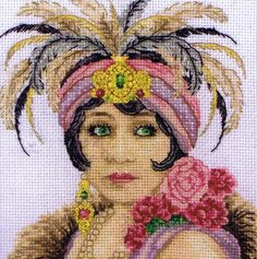 1920s Art Deco Portrait cross stitch kit by maia. Discontinued, but still available here. Ugh, I want this.