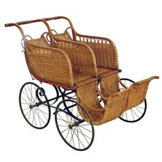Heywood American Twin Baby Carriage America Ca. 1910 Wicker and metal baby buggy with dual reclining seats and moveable footrest.