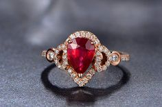 Engagement Ring 1 Carat Ruby Engagement Ring by stevejewelry, $2099.00. Not super fond of rubies but this one is gorgeous and its my birthstone