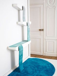 Cascade rug-originally intended to show how carpet can move gracefully from wall to floor, we think it would be a great idea to make cat climbing shelves a little more aesthetic!