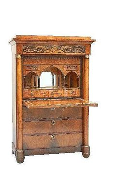 A fine early 19th century Biedermeier secretaire, veneered in figured  walnut, the stepped and moulded top above a penwork decorated drawer depicting Artfact.com