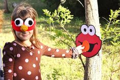 This listing is for PIN THE NOSE ON ELMO game ONLY.. the mask is not included... Its made out of cardstock paper and is adorable for any