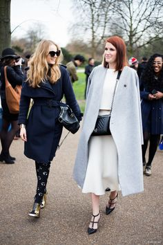 Kenzo eye print skinnies and a navy trench in London.