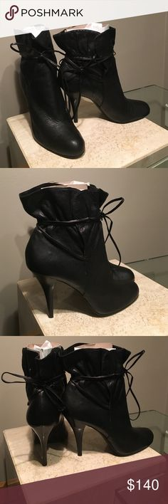 Black leather Tie me up Ankle boots! Black leather tie to front or the back ankle boots..Great with jeans ..Leggings or trousers or a Great skirt Calvin Klein Shoes Ankle Boots & Booties