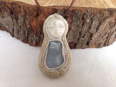 Celestite goddess stone necklace polymer clay on suede on Etsy, $35.00