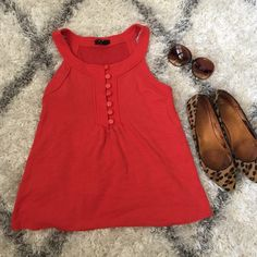 Forever 21 red-orange top with cute buttons, Small Reddish-orange top, worn, but in good condition. Super cute and fun. Great for summer! **listing is for shirt only** Forever 21 Tops