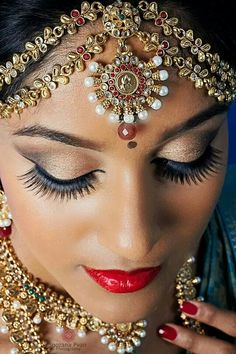 South Indian bride...I love this wedding makeup and wedding jewelry.....MAYBE!!!