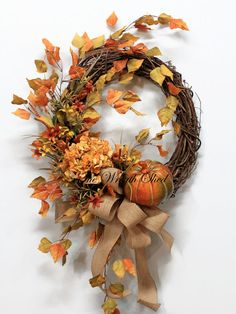 FREE SHIPPING!  Pumpkin Fall Wreath, a one of a kind country design from The Wreath Shed. Create a warm holiday welcome to your front door with this beautiful fall wreath. Included in this wreath is a pumpkin sitting on the grapevine, a beautiful fall hydrangea, fall wildflowers, hanging fall leaves, and a burlap bow with streamers. This artificial fall wreath is made on a 18 grapevine wreath base and finished is approximately 36 tall, 24 wide, 9 deep. I measure all my wreaths from tip to…