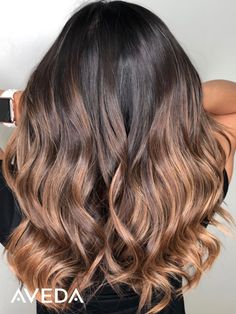 "Isn't this creamy rose gold caramel blended fall balayage gorgeous? Aveda Artist @brushedandpainted shares her brunette balayage formula with us: ""I free hand painted her hair with the viscosity whip formula and 40vol and in this session we did a backcombed foiliyage with enlightener and 10-20 volume. We toned with Demi+ 40g8n 4glightash 2 glightintenseash and 1g dkvb in permanent with 5 liquid developer."" Is this the fall hair color inspiration you need? Click to find an Aveda salon near…"