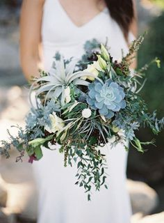 Elegant green succulent wedding bouquet with air plants, thistle and lisianthus