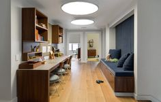 66-9th-Ave-EcoFriendly-Apt-10-kid-play Design Milk Love the kids office area and bench seating.