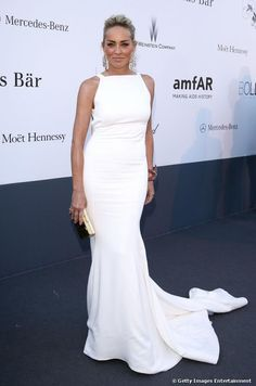 Sharon Stone dazzled in a white dress on the red carpet at the 20th Annual amfAR Cinema Against AIDS Gala during the 66th Cannes Film Festival, after having her make-up done by LOréal Paris, on 23 May 2013.