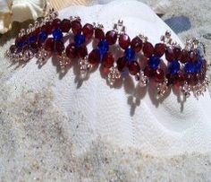 Ruby colored beads mixed with royal blue beads and copper colored seed beads. Available at theriveracollection.com