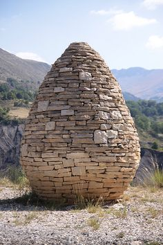CAIRN - man made pile of stone for many purposes (landmarks, religious, etc). Some are simple--some not.