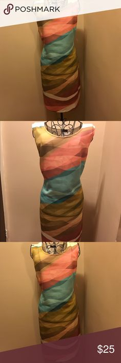 Beautiful summer dress BRAND NEW. Beautiful summer dress. NEVER WORN! 33 1/2 inches long. Stretchy material will hug your curves perfectly venus Dresses Midi