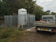 Steel palisade fence to make safe a gas storage tank in Bristol, supplied and installed by Palisade Fence, Garden Fencing, Bristol, Steel, Storage, Building, Garden Fences, Purse Storage, Buildings