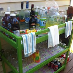 Turned our old changing table into a bar with a few cans of spray paint. I lined the shelves with fun contact paper from Homegoods. Easy, cheap, and fun! Woot! Now, time for a drink!