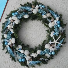 The sea is calling this holiday season and we've put together a list of 10 Beach Cottage Christmas Decor Ideas inspired by surf, sand, sea shells, and casual beach cottages. Coastal Christmas Decor, Nautical Christmas, Tropical Christmas, Gold Christmas Decorations, Cottage Christmas, Beach Christmas, Blue Christmas, Christmas Crafts, Christmas Ornaments