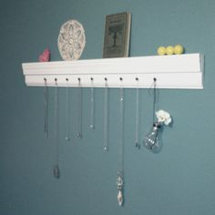 A necklace shelf for the bathroom. I need this.