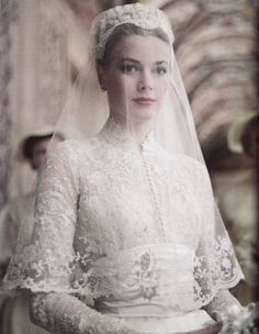 April American actress Grace Kelly marries Prince Rainier of Monaco. Photo: Princess Grace in her wedding dress, a gift from the MGM studio, designed by Academy Award Winning Costumer Helen Rose. Helen Rose, Celebrity Wedding Dresses, Celebrity Weddings, Famous Wedding Dresses, Princesa Grace Kelly, Grace Kelly Wedding, Grace Kelly Style, Kate Middleton Wedding Dress, The Bride