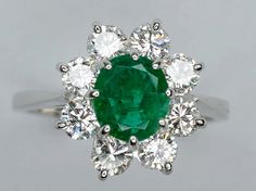 Platinum Diamond & Emerald Ring. By Morphy Auctions