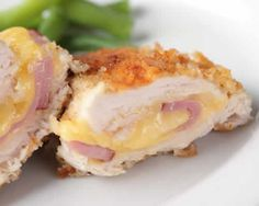 Cordon bleu, which is stuffed with slices of ham and cheddar cheese, is a gourmet meal of Schnitzel, a main dish usually prepared with beef in France. You can also make the cordon bleu recipe prepared from chicken meat at home because it is economical. Top Recipes, Gourmet Recipes, Dinner Recipes, Dinner Ideas, Cordon Bleu Recipe, Smoking Recipes, Chicken Cordon Bleu, French Kitchen, Ham And Cheese