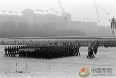 The Chinese PLA Army, Navy, and Air Force guard of honor marching through Tianamen Square in the 1984 Chinese National Day Parade.