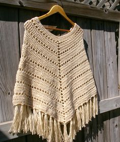 Kick up your heels in the perfect crochet poncho to keep you cozy and stylish all year round. This boho poncho is hand crocheted in wheat (ecru), with fringe added for fun.  Fits sizes S/M/L  Other colors and styles of ponchos are available here: https://www.etsy.com/shop/CandacesCloset?section_id=6944370&page=2  All items are handmade by me, never outsourced, in a smoke-free, pet-free home.  Visit our storefront candacescloset.etsy.com for more hand knit and crochected accessories.