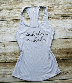 Inhale Exhale Yoga Tank top Work out tank, Gym tanks,Pilates tank,Workout tank, Funny tank tops, athletic apparel,Workout tanks,Gym Top Comfy lightweight tank top, perfect for working out Personolized design makes it a favorite shirt to wear. ★ Product Specifications ★ Classic fit In our studio we custom design, print and hand press graphics onto the garment, using only high-end imprinting techniques and materials, to make sure that you favorite shirt will last. ★ SIZE ★ Please scroll m...
