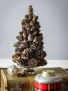 Love this DIY Rustic Pine Cone Tree! I would totally do this with the cinnamon scented pine cones! Pine Cone Christmas Tree, Tabletop Christmas Tree, Small Christmas Trees, Christmas Holidays, Natural Christmas Tree, Christmas Tree Candles, Holiday Tables, Outdoor Christmas, Christmas Lights