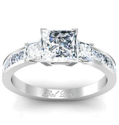 Princess cut three stone engagement ring.