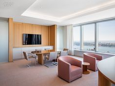 James Turrell Enlivens NYC Office  Cashmere upholsters the custom barrel chairs in an executive suite.