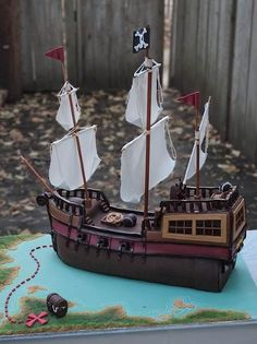Check out these fabulous details – the cannons, the railings, the sails, and the jolly roger – edible, all of it!  Well, maybe not the sails, but I'm sure if you tried hard enough...