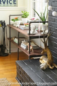 Primitive  Proper: Be Bold Challenge Reveal: Industrial Pipe Built Ins next to fireplace