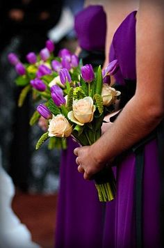 Cream rose and purple tulip bridesmaid bouquets from Whole Foods. Photo copyright J. Fiereck Photography.