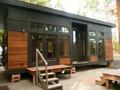 -High sqaure roof allows room for a loft bed - Wood planks and black matte materials create a raw industrial apearance