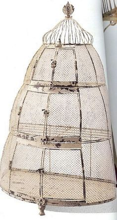 Bee Hive birdcage.  Long ago I saw one like this and if it has shelves it is a place to store vegs.