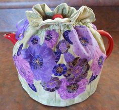 Tea pot cosy with machine appliqued fabric flowers.