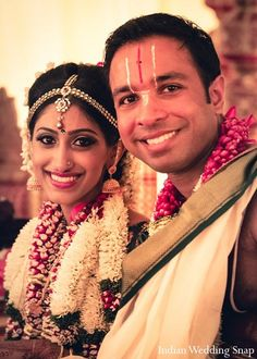 An Indian couple partake in traditional Tamil wedding ceremonies.