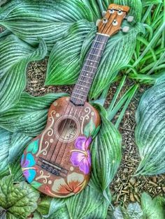 Hand-painted ukulele with hibiscus motif