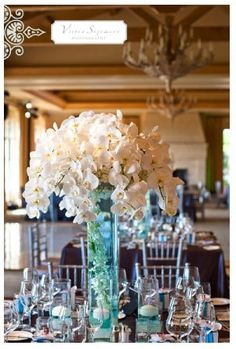 I want white flowers for my wedding and color the water blue with dye.