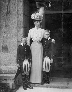 Queen Mary with her two eldest sons, Edward Prince of Wales (later King Edward VIII) and Prince Albert (later King George VI)